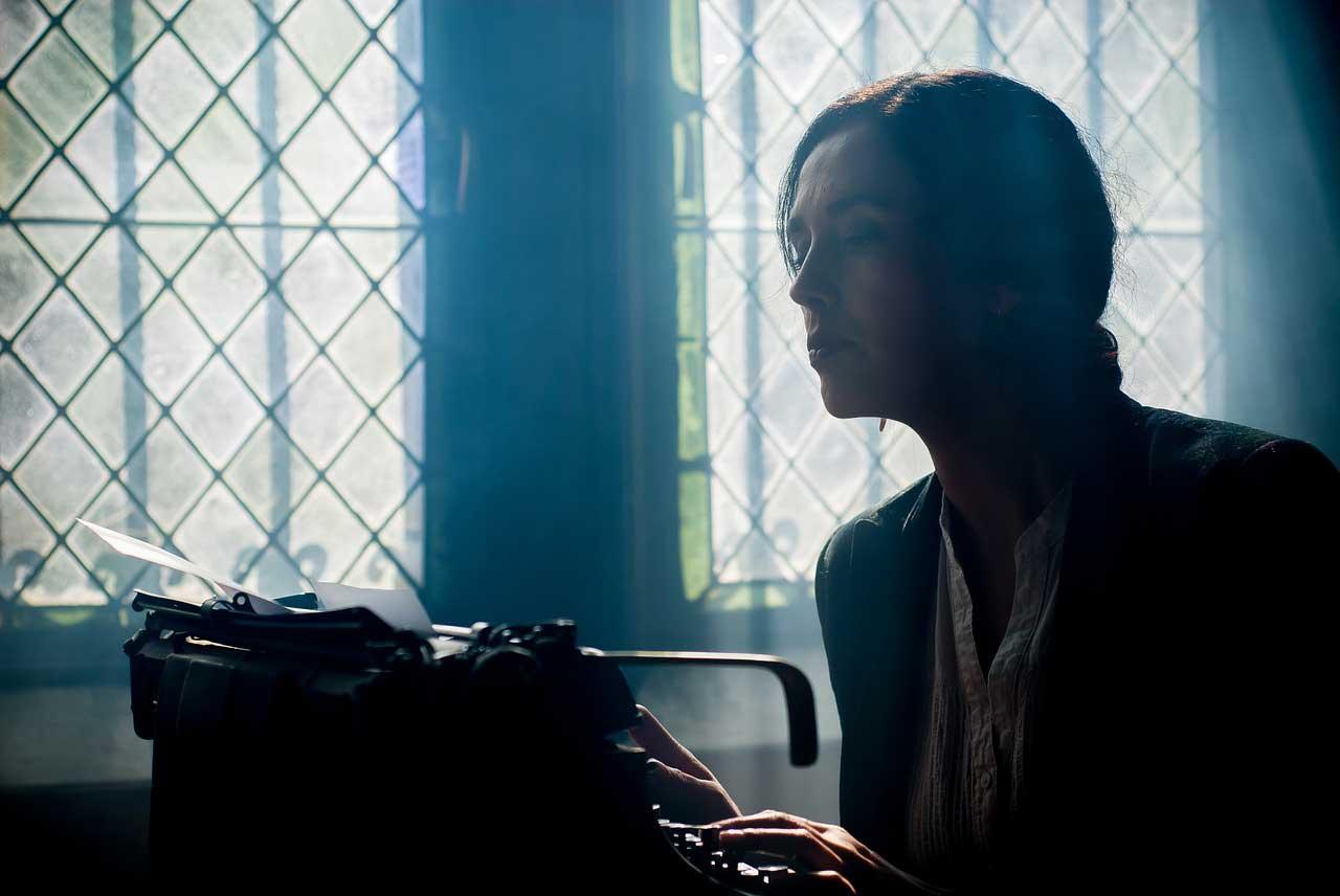 copywriter looking at typewriter